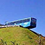 Bus overhangs on steep hill