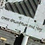 """come downtown and play."" on the Roof of Peabody Place Entertainment and Retail Center"