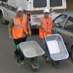 Guys with wheelbarrows